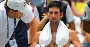 Novak Djokovic copes with the extreme heat while playing Marton Fucsovics in a first round-match at the U.S. Open on Aug. 28, 2018.