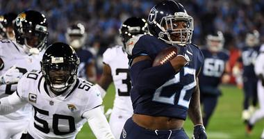 Titans running back Derrick Henry runs for a touchdown on Dec. 6, 2018, against the Jacksonville Jaguars at Nissan Stadium in Nashville, Tennessee.