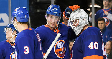 Oct 8, 2018; Islanders center Brock Nelson (29) congratulates New York Islanders goaltender Robin Lehner (40) on a shut out against the San Jose Sharks during the third period at Barclays Center. Mandatory Credit: Dennis Schneidler-USA TODAY Sports