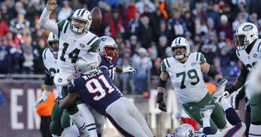 Dec 30, 2018; Foxborough, MA, USA; Jets quarterback Sam Darnold (14) fumbles the ball under pressure from New England Patriots defensive end Deatrich Wise (91) in the second half at Gillette Stadium. Mandatory Credit: David Butler II-USA TODAY Sports