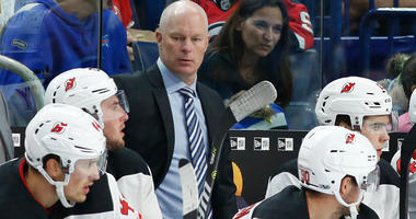 John Hynes watches play from the bench.