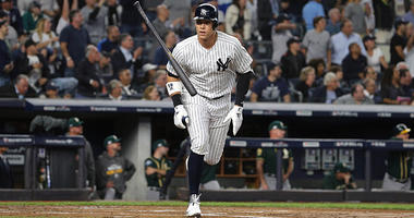 Oct 3, 2018; New York Yankees Aaron Judge tosses his bat after hitting an 2-RBI home run during the first inning against the Oakland Athletics in the 2018 American League wild card playoff baseball game at Yankee Stadium. Brad Penner-USA TODAY Sports
