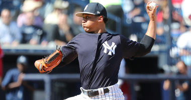 Justus Sheffield throws a pitch at spring training