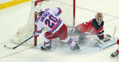 New Jersey Devils goaltender Keith Kinkaid makes a save on New York Rangers left wing Chris Kreider during the third period at Prudential Center on Apr 3, 2018.