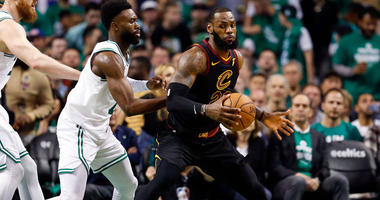 Cleveland Cavaliers forward LeBron James drives against Boston Celtics guard Jaylen Brown during Game 5 of the Eastern Conference finals on May 23, 2018, at TD Garden.