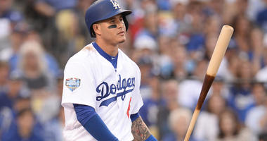 Oct 28, 2018; Los Angeles, CA, USA; Los Angeles Dodgers shortstop Manny Machado (8) reacts after striking out in the first inning against the Boston Red Sox in game five of the 2018 World Series at Dodger Stadium. Gary A. Vasquez-USA TODAY Images