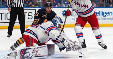 Sabres left wing Jeff Skinner and Rangers goaltender Henrik Lundqvist go after a rebound on Oct. 7, 2018, at KeyBank Center in Buffalo, New York.