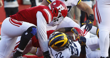 Nov 10, 2018; Piscataway, NJ, USA; Michigan Wolverines running back Karan Higdon (22) scores a touchdown against the Rutgers Scarlet Knights during the first half at High Point Solutions Stadium. Mandatory Credit: Noah K. Murray-USA TODAY Sports