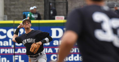 Yankees infielder Troy Tulowitzki throws to first base during a spring training game against the Philadelphia Phillies on March 17, 2019, in Clearwater, Florida.