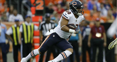 Trey Burton runs the ball in the first quarter against the Denver Broncos at Broncos Stadium at Mile High.