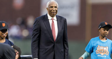 Baseball legend Frank Robinson stands on the mound before the game between the San Francisco Giants and the Los Angeles Dodgers at AT&T Park.
