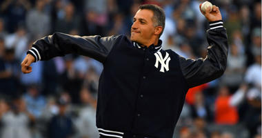 Andy Pettitte throws the ceremonial first pitch before game five of the 2017 ALCS playoff baseball series between the New York Yankees and the Houston Astros at Yankee Stadium