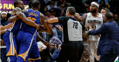 DeMarcus Cousins and Kevin Durant are held back from each other prior to both players being ejected during the fourth quarter at the Smoothie King Center in New Orleans.