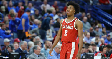 Collin Sexton smiles to the crowd during the second half of the quarterfinals of the SEC Conference Tournament against the Auburn Tigers at Scottrade Center.
