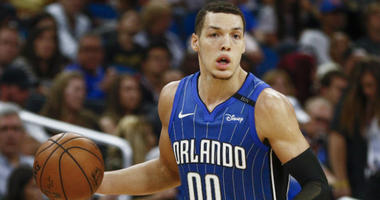 Aaron Gordon brings the ball down court against the Toronto Raptors during the second half at Amway Center in Orlando, Florida.