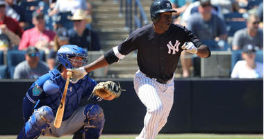 Estevan Florial hits a single during the sixth inning at George M. Steinbrenner Field.
