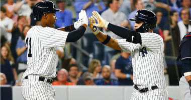 Gleyber Torres is congratulated by Miguel Andujar after hitting a three run home run. His first MLB home run against the Cleveland Indians during the fourth inning at Yankee Stadium.