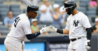 Miguel Andujar greets Gleyber Torres at home after Torres hit a home run in the ninth inning against the Baltimore Orioles at Yankee Stadium.