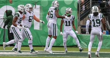 Jets wide receiver Terrelle Pryor celebrates a touchdown with wide receiver Robby Anderson (11) and teammates during the first half against the Indianapolis Colts on Oct. 14, 2018, at MetLife Stadium.