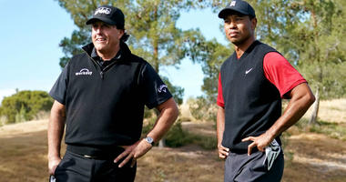 Phil Mickelson and Tiger Woods on the first tee during The Match: Tiger vs Phil golf match at Shadow Creek Golf Course.