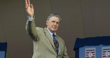 Tom Seaver waves to the crowd after being introduced during the Hall of Fame Induction Ceremonies at Clark Sports Center.