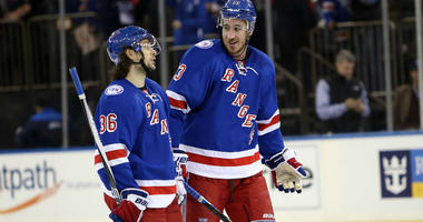 Kevin Hayes and Mats Zuccarello celebrate a 5-2 win over the Winnipeg Jets at Madison Square Garden.