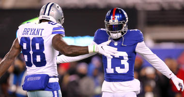 Odell Beckham Jr. greets Dallas Cowboys wide receiver Dez Bryant during warmups before a game at MetLife Stadium