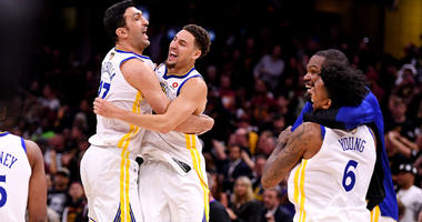 Golden State Warriors center Zaza Pachulia (left) celebrates with teammate Klay Thompson (11) after beating the Cleveland Cavaliers in Game 4 of the NBA Finals at Quicken Loans Arena in Cleveland.