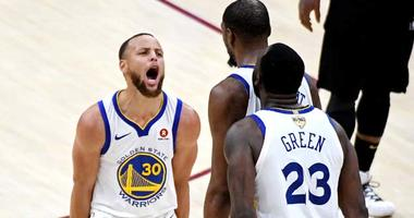 Warriors guard Stephen Curry celebrates with teammates during the fourth quarter against the Cleveland Cavaliers in Game 3 of the NBA Finals on June 6, 2018, at Quicken Loans Arena.