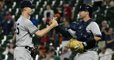 Yankees relief pitcher Chasen Shreve and catcher Kyle Higashioka celebrate after defeating Baltimore Orioles 9-0 on July 11, 2018, at Oriole Park at Camden Yards in Baltimore.