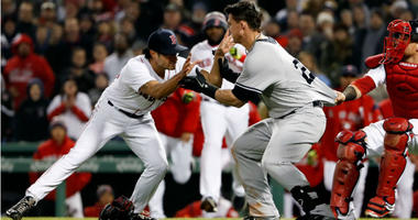 Tyler Austin starts a scrum with Joe Kelly during the seventh inning at Fenway Park.