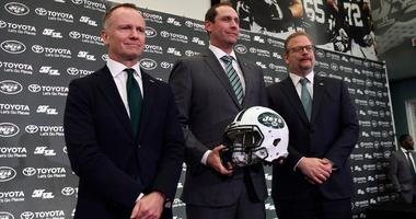 New York Jets CEO and chairman Christopher Johnson, new head coach Adam Gase, and general manager Mike Maccagnan pose for photos after a press conference on Monday, Jan. 14, 2019, in Florham Park.