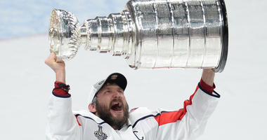 Washington Capitals left wing Alex Ovechkin hoists the Stanley Cup after defeating the Vegas Golden Knights in Game 5 of the Stanley Cup Final on June 6, 2018, at T-Mobile Arena in Las Vegas.