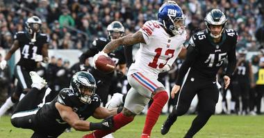Giants wide receiver Odell Beckham Jr escapes a tackle by Eagles linebacker Kamu Grugier-Hill during a punt return on Nov. 25, 2018, at Lincoln Financial Field in Philadelphia.
