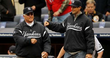 Former Yankees Bucky Dent and Aaron Boone walk onto the field to throw out the ceremonial first pitch prior to the Yankees playing against the Texas Rangers in Game 5 of the ALCS on Oct. 20, 2010, at Yankee Stadium.