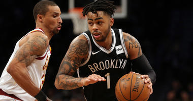 Nets guard D'Angelo Russell drives around the Cavaliers guard George Hill on March 25, 2018, at the Barclays Center.