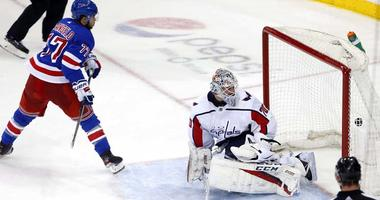 Rangers defenseman Tony DeAngelo scores against Washington Capitals goaltender Braden Holtby (70) during the shoot-out at Madison Square Garden on March 3, 2019.