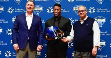 Giants coach Pat Shurmur (left), first-round draft pick Saquon Barkley (center) and general manager Dave Gettleman pose for a photo during a news conference on April 28, 2018, at Quest Diagnostics Training Center in East Rutherford, New Jersey.