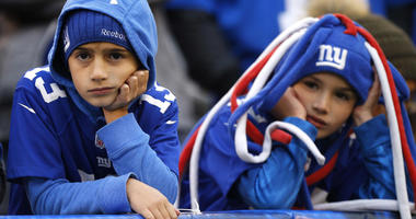 Dejected New York Giants watch play the fourth quarter against the Washington Redskins at MetLife Stadium.