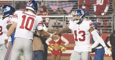 Giants wide receiver Odell Beckham is congratulated by quarterback Eli Manning (10) for scoring a touchdown against the Giants during the third quarter on Nov. 12, 2018, at Levi's Stadium.
