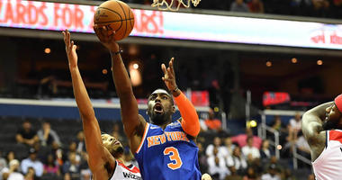 Knicks guard Tim Hardaway Jr. shoots against Washington Wizards forward Otto Porter Jr. on Oct. 1, 2018, at Capital One Arena in Washington.