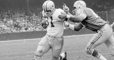 In this Nov. 22, 1962, file photo, Green Bay Packers fullback Jim Taylor (31) is brought down by Detroit Lions' Dick Lane in the third quarter of an NFL football game in Detroit.