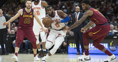 Knicks guard Kadeem Allen drives to the basket between Cavaliers guard Matthew Dellavedova (18) and forward Marquese Chriss (3) on Feb. 11, 2019, at Quicken Loans Arena in Cleveland.
