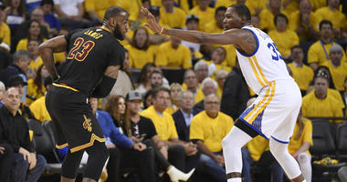 Cleveland Cavaliers forward LeBron James is defended by Golden State Warriors forward Kevin Durant during Game 5 of the NBA Finals on June 17, 2017, at Oracle Arena in Oakland, California.