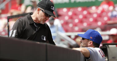Third-base umpire Jerry Meals (left) talks with Mets manager Mickey Callaway during the first inning against the Cincinnati Reds on May 9, 2018, at Great American Ball Park.