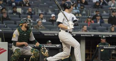 The Yankees' Neil Walker hits an RBI single during the 11 inning against the Oakland Athletics on May 12, 2018, at Yankee Stadium.
