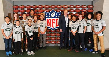 NFL Commissioner Roger Goodell poses for a photo with the Jets 13-14 girls and boys NFL flag champions during the NFL Experience Times Square opening celebration on Nov. 30, 2017.