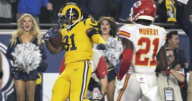 Rams tight end Gerald Everett (81) scores a touchdown in the fourth quarter against the Kansas City Chiefs on Nov. 19, 2018, at the Los Angeles Memorial Coliseum.
