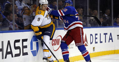Rangers defenseman Brady Skjei checks Predators left wing Filip Forsberg on Oct. 4, 2018, at Madison Square Garden.