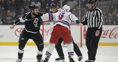 Kings left wing Kyle Clifford (left) and Rangers left wing Cody McLeod (8) fight on Oct. 28, 2018, at the Staples Center in Los Angeles.